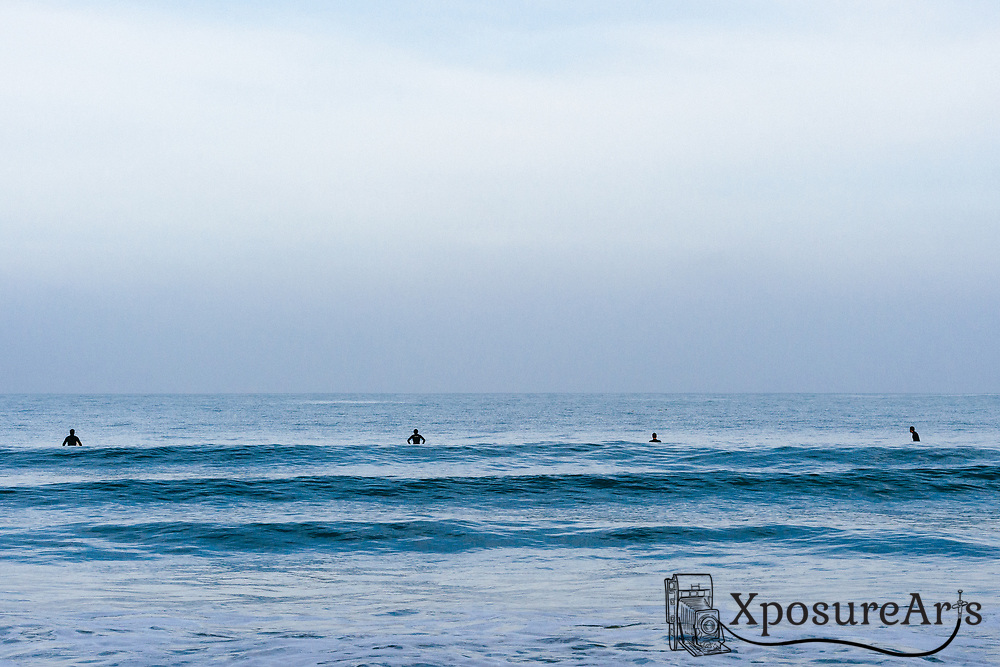 Surfers waiting for wave at beach in Pacifica